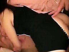 Two beautiful and horny Asian girls share a sex toy and a r