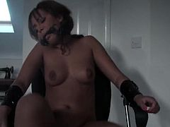 Black girl tied to a chair as a toy pleasures her pussy