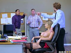 It was too hot in the office, so Kagney removed her shirt. She was feeling tired, so she removed her bra too, and started to massage her big boobs. Her huge melons looked really seducing, so she was not surprised, when one of the co-workers grabbed her tits from behind, and pinched her hard nipples...
