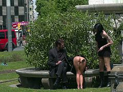 What's going on? Dressed only in a short skirt, topless and without panties, with hands tied behind the head, brunette babe is walking down the crowded streets. Then she stops to have a rest and to get a fresh portion of slaps from the ruling mistress, near the monument. Rough humiliation in public!
