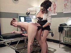 Barbary needed an exam from Dr. Siouxsie, but this is no ordinary doctor! The dominant woman bends the redhead over and spanks her, while fisting her. The fun doesn't stop there. Rather, it is just getting started.
