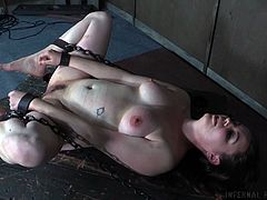 Amy is chained up, and she's down for kinky stuff, but maybe she's having second thoughts about this. Her pussy, ass and the rest of her body for that matter are exposed to her executor and his cattle prod.