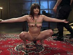 This video shows the painful experience of Alison Rey in The Training of O. Just like other sex slaves, she must had to pass through this brutal and humiliating training. Her hands and boobs were tied with ropes, and a guy inserted a stick in her pussy. He pinched her nipples with clamps and fucked her throat.