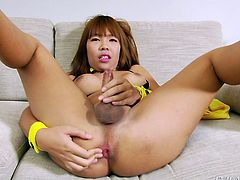 Yuki is looking stunning in a tiny micro bikini that shows off all her womanly curves. The cute ladyboy plays with her perfect cock. The erotic chick with a dick pulls back her foreskin faster and faster, until she is about to blow her load. Look at how she spreads her asshole wide.
