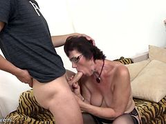This boy turns into a man, as an old lady in black stockings takes his whole penis in her mouth. Watch as her covered in lipstick lips surround the shaft and she sucks it deep, and long! The mature lady takes his load in her deep pussy. He just can't stop fucking her, as they enjoy each other in bed.