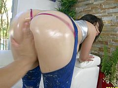 Look at that ass! Have you ever seen anything so hot and wonderful? Her thick booty is oiled up, which makes it shiny and oh so fuckable, but she didn't forget about her plump natural tits either. Those are covered in oil, too. I tore open her leggings and fingered that hole.