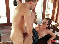 Modest chick Roxanne Rae is fucked by impudent dude right on the table