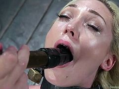 Slender blonde babe Lily Labeau, is today's guest at Device Bondage and she will receive almost all possible bdsm pleasures here. She will be placed in a special bondage device, with glass pumps on her tits and dildo in her hairy pussy. Only pleasure awaits her... Enjoy!