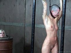 Abigail is tied up and being whipped by not one, but two executors. The male exits for a bit, while the other woman takes over, rapidly tagging the naked submissive over and over again all over her body.