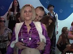 Dorina Gold and Eva Zappa are beginning to feel aroused, as girls all around them are beginning to loosen up and taking off their bras, flashing other guys and gals but, one of the sluts is going to make the first move on one of the male strippers and give him a POV shot, deepthroat blowjob, while another blonde is laying on stage getting ass fucked.