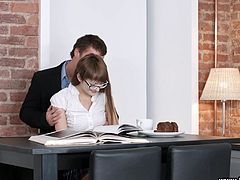 This nerdy babe was studying patiently, when her man came in to get naughty with her. She clearly needed a break from the math, because she was so horny. Sucking dick sounds a lot better than doing equations. She dropped to her knees and blew him, and he returned the favor by giving great cunnilingus.
