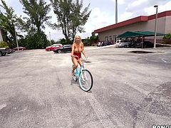 Nina Kayy is shameless, naughty babe. This busty babe likes riding bike topless, showing her amazing tits to the world. After exhausting bike ride, she comes home and oils up her boobs and big round ass. She truly is a very charming lady.