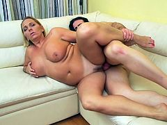 She may be fat and mature, but this sexy lady still likes to fuck, and she really has an attraction to horny men. She rode this dude's hard cock on the couch, hoping that he would cum a big load inside her old snatch. Watch as he thrusts deep inside her.