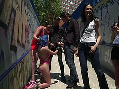These submissive babes get horny, if you dominate and humiliate them in public. The dominant mistress ordered them to beg strangers to blow their cocks and these chicks happily obliged. Strangers enjoyed free hot show, while some daring guys fully exploited their naked bodies and had fun.