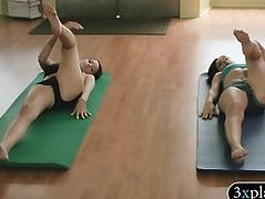 Pretty babes learning yoga exercises with yoga teacher