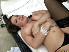 Brunette with gigantic breasts and clean snatch gets her pretty face covered in man goo