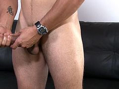 What's that poking out of Damon's underwear? Why it's his massive cock of course. The horny dude is hard and ready to bust a nut for you. Watch him beat off and stroke. Get ready to see his cum fly all over the place.