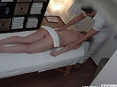 This cute blonde came in for a massage, plus some good sex. She didn't know about the cameras we put in to catch her in the act of screwing our masseuse after her massage. Now that's what we call a relaxing, full-release massage.