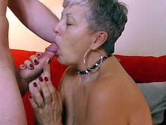 Lusty granny Savana has silver hair, but she takes the gold prize when it comes to cocksucking. Watch as she bares her big boobs and makes a horny jock's hard prick happy with her experienced hands and mouth, while he gives her shaved cunt a thorough fingering.