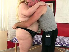 Blonde BBW gets her back massaged and then the masseur rubs her pussy and fuck her pussy with a dildo