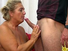 stunning mature lady sucks on a big cock