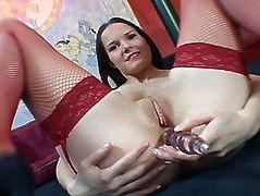 Cute young Carol loves her stockings & fingers in her twat