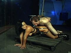 This mistress is about as cruel as they come. She is going to put her slave through some brutal cock and ball torture. The unlucky dude gets tied up and has rope wrapped around his cock, and nuts. Despite this, he still has to fuck her hard from behind.