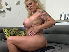 This busty blonde mature woman wants to have some fun. She sticks a big buttplug in her asshole and bends over to show off her butt. Look at how amazing that pussy is. She likes it when you are watching her play with herself.