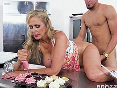 While this blonde busty cook was filling her cakes with tasty cream filling, I was busy filling her wet pussy with my warm semen. I was drilling her from behind and with every stroke, her huge tits were bouncing, smearing pastry cream throughout the table. Really naked chef!
