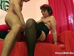 Emo grandma with pierced nipples and pussy gets fucked by a young cock in her sexy corset and fishnet stockings.