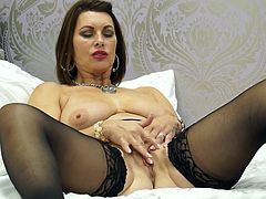 She is sensually licking her fingers and teasing you to come towards her. This elegant milf looks really sexy in her pantyhose and she wants you to come over and fuck. She will be playing with her pussy until you arrive.