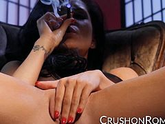 Romi Rain begins to masturbate while vaping and quickly grabs her glass dildo to finish herself off