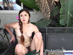 Cassidy Bliss masturbates outdoors on her chair