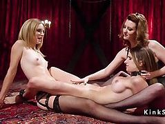Hard threesome lezdom whipping