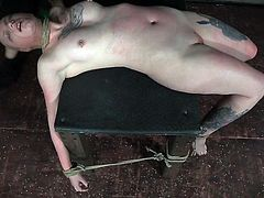 Paige is tied to the table, and it tests the flexibility of her sexy body. Despite the discomfort and pain, she starts to feel good when her executor puts that vibrator to her pussy and presses it against her. The torture is far from over, though.