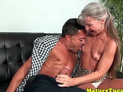 Longhair mature lady wanks off younger guy