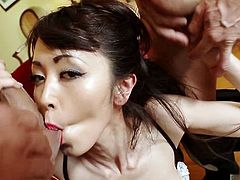 She dresses up in makeup and kinky, sexy lingerie to make herself appealing to the two guys she has invited over. They slam their cocks into her sweet little mouth and then fuck her hard, one cock in her cunt, another up her ass. Then, they shoot their hot loads all over her pretty face