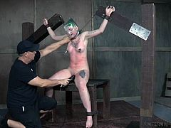 Paige is in our Infernal Restraints room, with our highly trained executor doing what he likes to her. She cries out in pain and pleasure from the vibrator, nipple clamps, and the whipping she endures. She will learn obedience today.