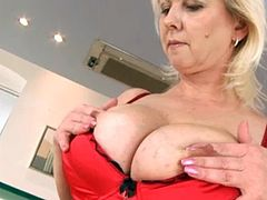 Sexy blonde mature plays with herself
