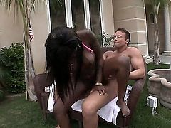 Tatiyana Foxx is a nasty black girl with appetite for white cock. She wraps her lips around stiff ivory cock ad then gets her cunt banged with legs apart. Watch dark skinned slut suck and fuck in the backyard.