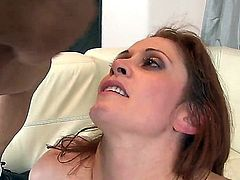 She does it as her husband watches. It is a big turn on for this redhead and for her husband to have sex with a strange men while her man is watching them.