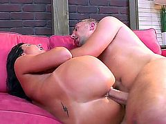 Hot bodied buxom brunette Lezley Zen has a good time humping on a pink couch in the middle of the room. Big racked brunette gets her wet milf pussy banged hardcore style and loves it!