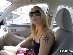 Barista blows in public parking lot at day