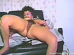 Vintage homemade video of a hot milf fucking her hairy muff with toys