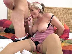 Join our company and enjoy blonde mature with huge, juicy tits sucking one long and hard penis. After she slurps his cock, she spreads wide, so her new lover can finger and tongue her tasty pussy. Relax and have fun!