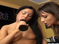 Brunette sees her girlfriend sucking on a big fat dildo, she knows that it wont be long before its sliding into her completely shaved snapper, as its her turn to reach a multiple orgasm.