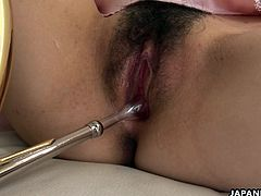 Asian pervert has a huge trombone in her pussy and she is using the blowing part as a penetration device. Then, once she's done, she gets to be fucked with a sex toy very properly.