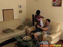 African amateur wraps her soft lips around a white dick. She gives an excellent blowjob and then gets fucked on the sofa.