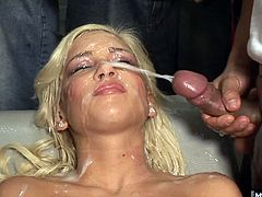 She starts out rubbing her pussy and playing with a dildo until we send a massive group of men in to give Kacey what she craves. One by one, these guys belly up to Kaceys innocent looking face and jack off load after load after load to give her dozens of facials and buckets of thick white semen all over her pretty face