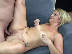 This blonde milf can't get enough of her man's big juicy dick. After some foreplay she opens her legs to take the dick deep down into her warm vagina. Will she let her man cum inside of her hot pussy?